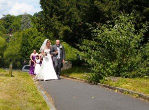 Proud Dad and Bride just entering Church in Llangollen , Wrexham