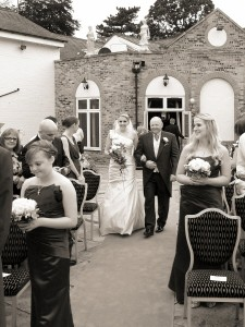 Bride & proud dad at outdoor ceremony at Rossett Hotel
