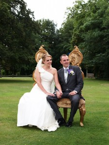 Bride and groom relaxing during witness signing during ceremony at Llyndir Hall